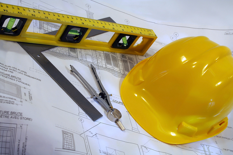 hard hat with architectural plan
