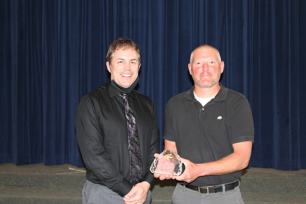 Dr. Mark Mulvihill (left) presents award to Carter Wells